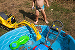 My younger son, age two, spends as much time putting toys in his wading pool as he does swimming in it.