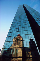 John Hancock Tower with Trinity Church reflection, Boston, Massachusetts, The tower, the tallest in the city, was designed by Henry N. Cobb of Pei Cobb Freed &amp; Partners