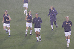 27 April 2008: U.S. players (from left): Amy Rodriguez (USA), Heather Mitts (USA), Angela Hucles (USA), Rachel Buehler (USA), and Lindsay Tarpley (USA) warm up in a heavy rain storm. The United States Women's National Team defeated the Australia Women's National Team 3-2 at WakeMed Stadium in Cary, NC in a rain delayed women's international friendly soccer match.