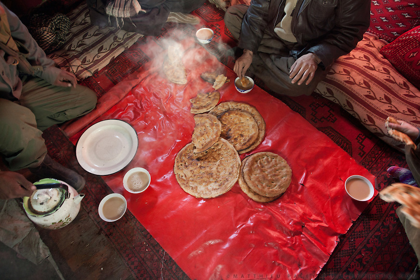 Breakfast of salty tea and flat bread..The Kyrgyz settlement of Tchelab, near Chaqmaqtin lake, Haji Bootoo Boi's camp...Trekking through the high altitude plateau of the Little Pamir mountains, where the Afghan Kyrgyz community live all year, on the borders of China, Tajikistan and Pakistan.