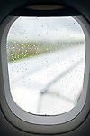 view from window of an airplane during a rainy day