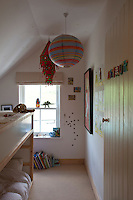 The children's bedroom is furnished with bunk beds and a striped pendant light