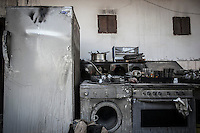 Forniture damage during a fire in a house at Taftanaz village. The Syrian army have carried out several attacks into the city where allegedly have burnt more than 200 houses.