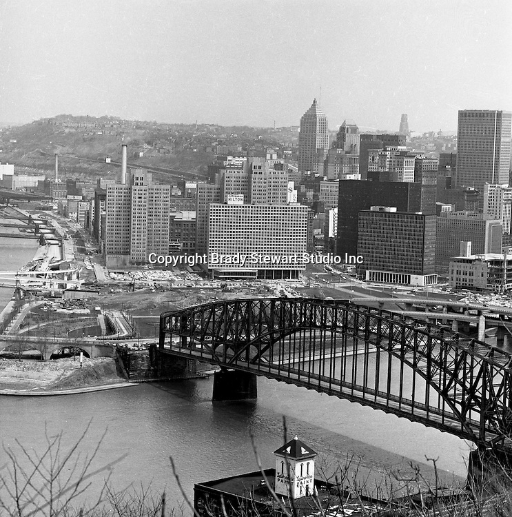 Pittsburgh PA:  View of Gateway Center and the city of Pittsburgh from Mount Washington - 1962. Point Bridge in the foreground and the clearing the point area for the Gateway towers and Point State Park.