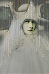 Conceptual image of female wearing strange gown covering head