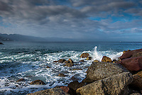 Fine Art Photograph of a seascape scene in Puerto Vallarta Mexico. The morning lighting was perfect as the long rays of the morning sun brought out the textures and details of clouds, and the ocean waves crashing down onto the rocky shoreline.