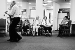 CHAD PILSTER &bull;&nbsp;Hays Daily News<br /> <br /> Treva Benoit, left, the Director, dances with Earl Brenner, a guest, as (left to right) Lois Wheeler, resident, Bea Seba, resident, Cletis Hammerschmidt, resident, Marie Litzenberger, resident, Dorothy Fulton, family member, watch on Thursday, October 17, 2013 as polka music is played by the Wes Windholz Band at the Cedar View Assisted Living Residence in Hays, Kansas. The Wes Windholz Band plays the third Thursday of every month at area retirement homes.