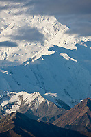 Clouds drift past Pioneer ridge, Mt McKinley, Denali National Park, interior, Alaska.