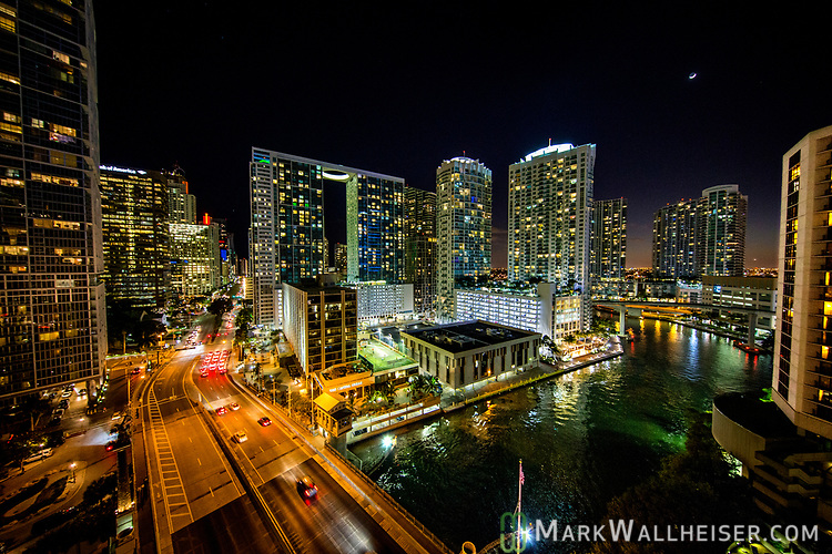 The downtown Miami skyline overlooking Brickell Street and the Miami River in Miami, Florida.