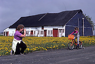 Ile D'Orleans, Quebec City Area, Canada, June 8, 1984. Morning cycling along the flowered fields.