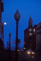 Downtown Marquette, Mich. with a full moon at dusk.
