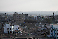 "In this Saturday, Aug. 16, 2014 photo, an overview of Beit Hanoun neighborhood after it was hit by airtrikes and artillery shelling during the ""Protective Edge"" Israeli military operation in Gaza Strip. (Photo/Narciso Contreras)"