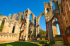 Altar area of Fountains Abbey , founded in 1132, is one of the largest and best preserved ruined Cistercian monasteries in England. The ruined monastery is a focal point of England's most important 18th century Water, the Studley Royal Water Garden which is a UNESCO World Heritage Site. Near Ripon, North Yorkshire, England