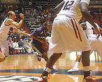 "Alcorn State's Keith Searcy (1) dribbles against Ole Miss guard Will Bogan (3) at the C.M. ""Tad"" Smith Coliseum in Oxford, Miss. on Thursday, December 29, 2010. Ole Miss won 100-62. (AP Photo/Oxford Eagle, Bruce Newman)"