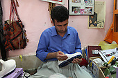 SULAIMANIYAH, IRAQ: Kaywan Hawrami (27) puts the final touches on a pair of klash...Klash are traditional hand made Kurdish shoes. Klash were originally made by members of the gypsy Dom tribe but are now made by numbers of different Kurds in the Hawraman region along the Iraq/Iran border...Photo by Besaran Tofiq/Metrography