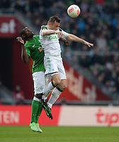 FUSSBALL   1. BUNDESLIGA   SAISON 2012/2013    30. SPIELTAG SV Werder Bremen - VfL Wolfsburg                          20.04.2013 Assani Lukimya (SV Werder Bremen) gegen Ivica Olic (re, VfL Wolfsburg)