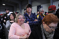 Trump supporters inside the Synergy Flight Center to hear Republican front runner Donald Trump speak in Bloomington, Illinois on March 13, 2016.