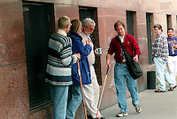 Scott Bass  manuevers his way along a downtown Seattle sidewalk.  Bass has Usher's Syndrome 1, a genetic condition that causes deafness at birth and a loss of peripheral vision with age.  Over time, this tunnel of vision closes in, leading to total blindness.  Scott lost his sight at 23.  He taps sidewalks and the sides of buildings- called trailing- for guidance, often having to manuever around people to get where he's going.  Bass works full time and lives and travels independently.
