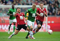 FUSSBALL   1. BUNDESLIGA   SAISON 2012/2013   3. SPIELTAG Hannover 96 - SV Werder Bremen     15.09.2012 Szabolcs Huszti (li) und Artur Sobiech (re, beide Hannover 96) gegen Aaron Hunt (Mitte, SV Werder Bremen)