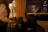 "San Francisco, California, January 5, 2011 -Linda Sharp takes her medication to help manage the symptoms of her Parkinson's disease in her hotel suite the night before her Interventional MRI (or iMRI) surgery at University of California San Francisco Medical Center. She says she has to take medicine every three hours. Ms. Sharp was diagnosed with Parkinson's disease about ten years ago and has steadily seen her condition decline. She says that she read everything she could on the subject and decided to try the iMRI at the suggestion of her neurologist, Dr. Chad Christine, a doctor at UCSF. Her PD has progressed to a point where the movement disturbances could no longer be alleviated with medication. She says she is hopeful about the surgery. ""I just want my quality of life back."" She added that she misses going out to dinner with her husband, taking walks along the beach where she lives and being able to read before going to bed. The procedure does not cure the disease, but should alleviate the symptoms for 7-10 years giving Ms. Sharp the opportunity to regain some of these simple pleasures. ..The iMRI procedure uses Deep brain stimulation (DBS), which has been used for over a decade to treat movement disorders such as Parkinson's disease, essential tremor, and dystonia. DBS uses a pulse generator implanted in the chest, similar to a pacemaker, to deliver pulses to specific regions of the brain via a permanently implanted electrode. In the U.S., DBS is normally done while the patient is awake, because the surgeon needs to induce the symptoms (like the involuntary movements of Parkinson's) to know if he's in the right place, and if the patient is unconscious, the symptoms can't be induced. Many patients find it hard to tolerate."