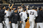 Ole Miss' Matt Snyder (33) is congratulated by teammates after his 9th inning single scored Ole Miss' Tanner Mathis (12) with the winning run against Arkansas State at Oxford University Stadium in Oxford, Miss. on Wednesday, February 23, 2011. Ole Miss won 4-3 and improved to 5-0 on the season.