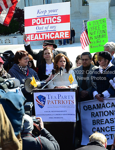 United States Representative Michele Bachmann (Republican of Minnesota) makes remarks to demonstrators outside the U.S. Supreme Court Building as oral arguments concerning the Constitutionality of the U.S. Health Care Law continue inside the building.  .Credit: Ron Sachs / CNP