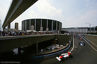 DETROIT, MI - JUNE 22: Alain Prost in the McLaren MP4-2C/TAG TTE PO1 drives ahead of a group of cars during the Detroit Grand Prix on June 22, 1986, on the Detroit temporary street course in Detroit, Michigan.