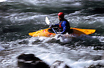 A kayaker runs Tumwater Canyon on the Wenatchee River outside of Leavenworth, Washington.