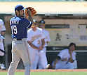 Koji Uehara (Rangers),AUGUST 13, 2011 - MLB :Hideki Matsui (R) of the Oakland Athletics watches Koji Uehara #19 of the Texas Rangers from the dugout as he pitches during the game against the Oakland Athletics at O.co Coliseum in Oakland, California, United States. (Photo by AFLO)