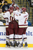 BC celebrates Tommy Cross's goal which made it 4-2 with 18 seconds remaining in the second period. - The Boston College Eagles defeated the Northeastern University Huskies 5-4 in their Hockey East Semi-Final on Friday, March 18, 2011, at TD Garden in Boston, Massachusetts.