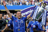 Chelsea's John Terry celebrates with the Premier League Trophy during Chelsea vs Sunderland AFC, Premier League Football at Stamford Bridge on 21st May 2017