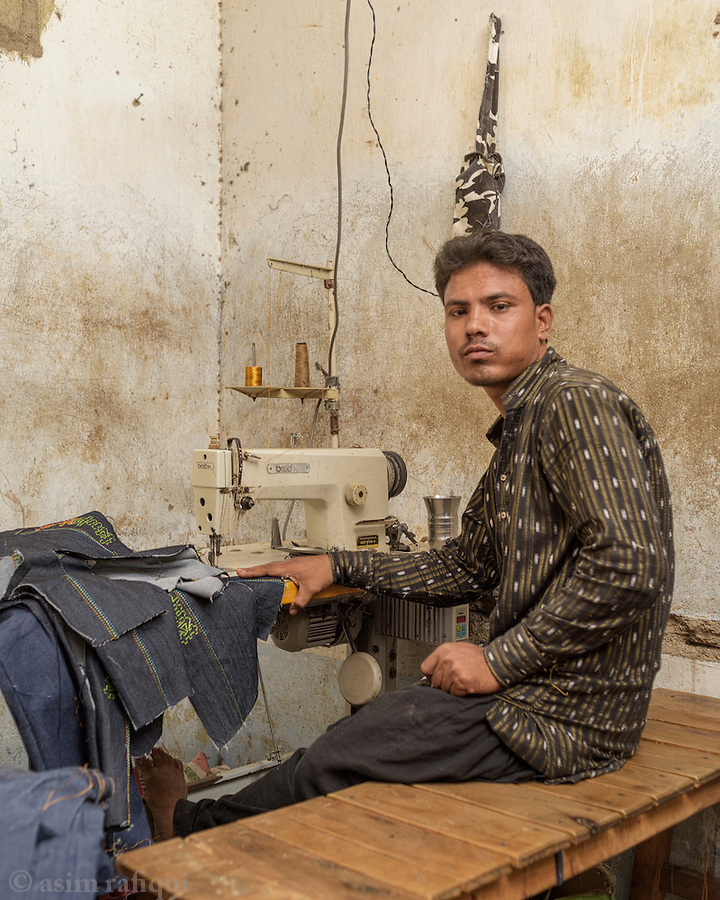 Mohammad Farid - a garment worker in Karachi who owns and runs a small sewing and stitching factory located within the Bengali slum community. These small scale operations produce clothing for the local markets and are usually operated with the help of 8-10 local workers. With many without jobs, these small workshops have access to cheap(er) labor as people are desperate to find any work.