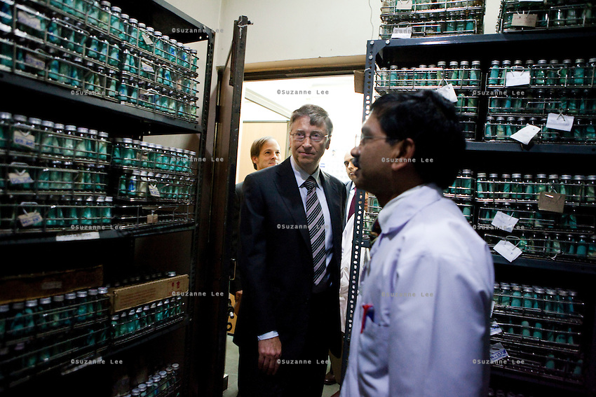 Bill Gates (center), co-chairman of the Bill and Melinda Gates Foundation (BMGF) enters the culture room as doctors give him a tour of the Lala Ram Swawrup (LRS) Institute of Tuberculosis and Respiratory Diseases in New Delhi, India on 24th March 2011.