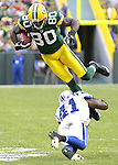 .Green Bay Packers' Donald Driver is tackled by Indianapolis Colts' Antoine Bethea after a 5-yard gain on a Aaron Rodgers pass in the 2nd quarter. .The Green Bay Packers hosted the Indianapolis Colts at Lambeau Field Sunday October 19, 2008. Steve Apps-State Journal.