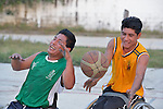 Alejandro Jarquin (left) and Roel Hernandez battle over the basketball during a practice session in Zipolite, a town in Oaxaca, Mexico. Jarquin and Hernandez play on the Oaxaca Costa wheelchair basketball team.