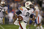 Auburn quarterback Cam Newton runs the ball against UK at Commonwealth Stadium on Saturday, Oct. 9, 2010. Photo by Scott Hannigan | Staff
