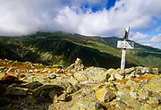 Tuckerman Ravine (left) Mount Washington (top) and Huntington Ravine straight ahead to the right engulfed in cloud cover from along the Boott Spur Trail in the New Hampshire White Mountains.