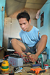 Marjo Lardera, 27, was born without arms but uses his feet and toes to earn a living repairing appliances and electronics in Concepcion, Philippines. The town bore the brunt of Typhoon Haiyan, known locally as Yolanda, in November 2013. The storm damaged his house and killed one brother. Lardera is a member of the local People with Disabilities (PWD) group.