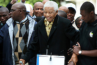 Former president Nelson Mandela casts his vote for the African National Congress (ANC) at the Killarney Country Club in Houghton, Johannesburg on the day of the 2009 general election.