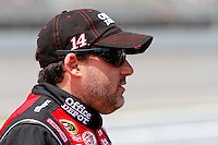 19 June, 2011: Tony Stewart waits during qualifying for the 43rd Annual Heluva Good! Sour Cream Dips 400 at Michigan International Speedway in Brooklyn, Michigan. (Photo by Jeff Speer :: SpeerPhoto.com)