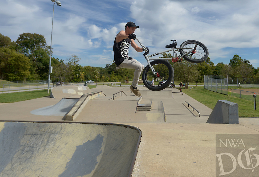 NWA Democrat-Gazette/BEN GOFF @NWABENGOFF<br /> Coleman Benton of Rogers works on a 'tail whip' on Sunday Oct. 10, 2016 while riding at the skate park at Memorial Park in Bentonville.