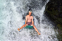 Nootka Island, British Columbia, Canada, August 2006. A daredevil prepares to descend the falls on a boogieboard. The waterfalls of Calvin Creek are the highlight of the Nootka Trail. One can camp on the beach directly in front of the falls while taking a refreshing plunge inside. Trekking the Nootka trail takes hikers through dense rainforest and along beaches full of marine life. Photo by Frits Meyst/Adventure4ever.com.