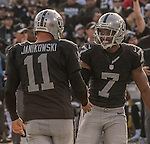 Oakland Raiders punter Marquette King (7) congratulates kicker Sebastian Janikowski (11) on third field goal of the first half on Sunday, December 04, 2016, at O.co Coliseum in Oakland, California.  The Raiders defeated the Bills 38-24.