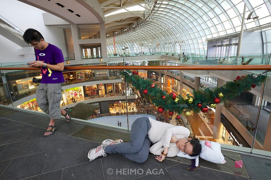 Singapore. Marina Bay Sands. Having a nap at the Shopping Mall.