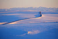 James Dalton Highway transects snow covered tundra of Alaska's arctic coastal plains. Philip Smith mountains, Alaska.