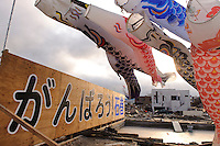 """A sign saying """"Try hard Ishinomaki"""" and Children's Day streamers, Ishinomaki, Miyagi Prefecture, Japan, May 5, 2011. Almost two months after the devastating earthquake and tsunami the reconstruction has barely begun."""