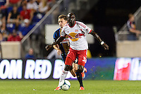 Ibrahim Sekagya (32) of the New York Red Bulls is marked by Jack McInerney (9) of the Philadelphia Union. The New York Red Bulls and the Philadelphia Union played to a 0-0 tie during a Major League Soccer (MLS) match at Red Bull Arena in Harrison, NJ, on August 17, 2013.