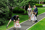 After their ceremony, <br /> the bride and groom share the happy moment with four of their eight grandchildren on a path outside Scarborough Presbyterian Church.