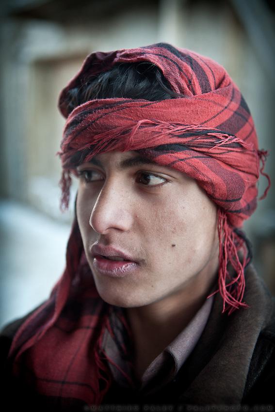 Portrait of a porter in the border town of Ishkashim, on the Tajikistan - Afghanistan border. Hindukush mountains.