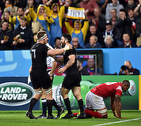 Nehe Milner-Skudder of New Zealand is congratulated on his second half try. Rugby World Cup Pool C match between New Zealand and Tonga on October 9, 2015 at St James' Park in Newcastle, England. Photo by: Patrick Khachfe / Onside Images